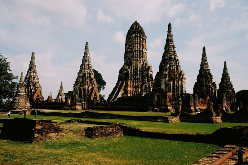 Religion Spirituality Place Of Worship Architecture History Built Structure Grass Building Exterior Travel Destinations Old Ruin Day Travel Sky Ancient No People Statue Ayutthaya Temples Ayutthaya Ayutthaya Historic Park Thailand Outdoors Ancient Civilization Nature