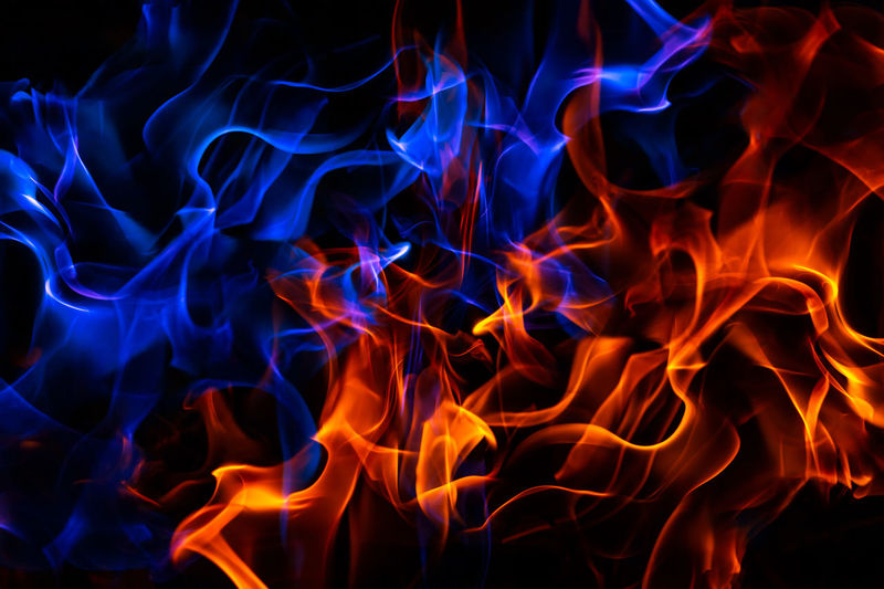 Red and blue fire on balck background composite image