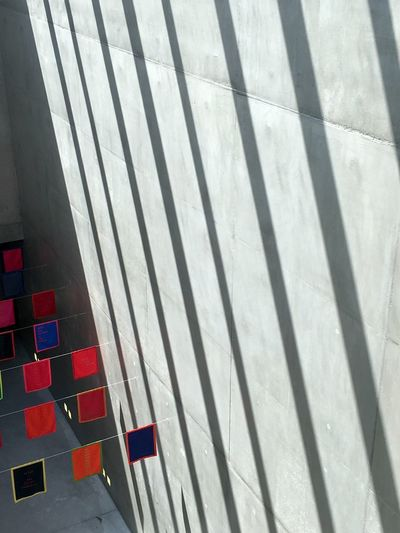 Striped Pattern Shadow Sunlight Pattern Day No People High Angle View Wall - Building Feature Red Architecture Striped Built Structure City Close-up