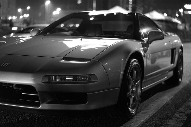 Front view of Acura/Honda NSX Modern Classic Collector's Car Pop Up Headlights Blackandwhite Black And White Photography 3.0L 3.2l Honda Momo NA1 NA2 NSX Acura NSX Type S SSR Type C Car Honda Nsx Limited Edition Mode Of Transportation Motor Vehicle Nsx Titanium Titanium Gear Knob Transportation Type S Woonhong Vintage Car