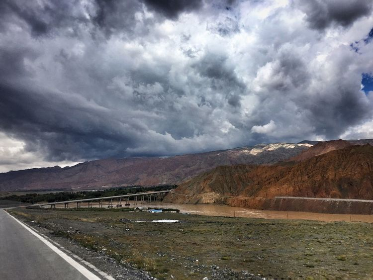 Road Landscape Transportation Tranquil Scene Long Cloud Solitude Mountain Countryside Tranquility Non-urban Scene Remote Country Road Cloudy The Way Forward Sky Overcast Scenics Mountain Range Day