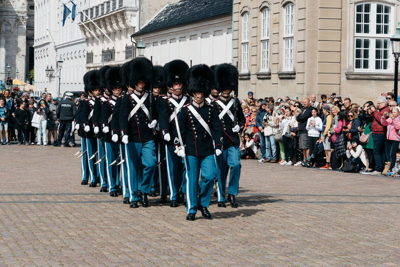 Changing guards parade in Amalienborg Palace in Copenhagen Amalienborg Bearskin Bearskinhat Guards King Landmark Military Parade Protection Royalty Scandinavia Soldiers Tradition Traditional Clothing Travel Travel Destinations Uniforms