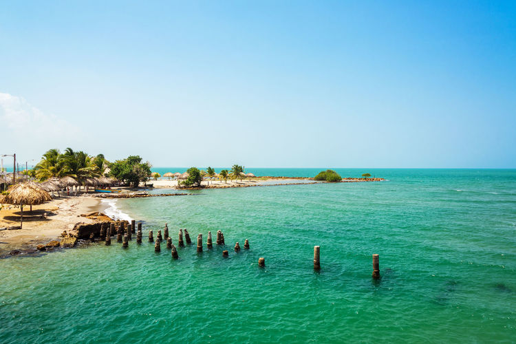 Colombian coast between Covenas and Tolu with a beach and old dock visible Beach Beautiful Boat Caribbean Coast Colombia Coveñas Day Idyllic Landscape Nature Nature Outdoors Palm Sand Scenics Sea Sky Table Tables Tolu Travel Tree Tropical Water