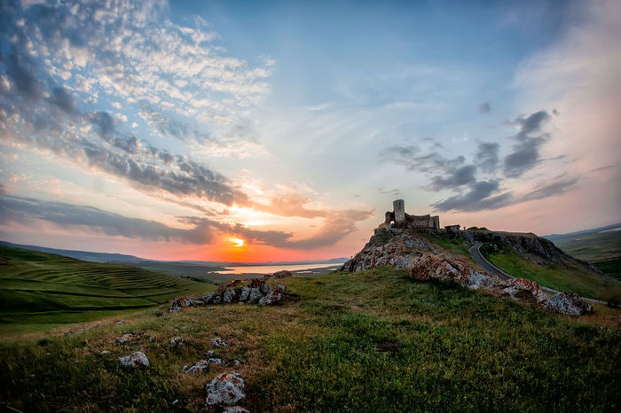 Arhitecture Grass Beauty In Nature Blue Citadel Clouds Dusk Evening Fields Hill History Lake Landscape Nature Old Buildings Outdoors Rocks Scenics Sky Stone Stronghold Sun Sunset Tranquility Travel Destinations