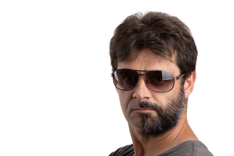 Portrait of man wearing eyeglasses against white background