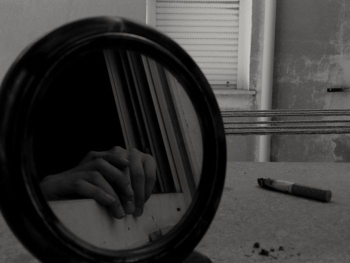 Day Indoors  Outdoors Wall Human Body Part Building Exterior Tranquil Scene Windowview Window Dark Black Blackandwhite Cigarette  Smoke Mirror Mirror Reflection Hands