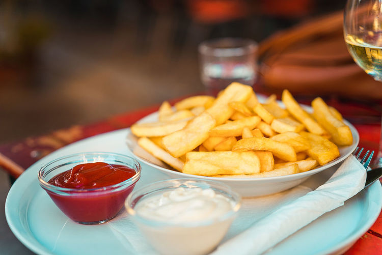 Close-up of french fries on table