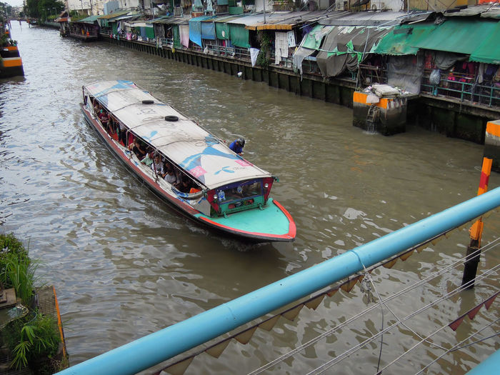 High angle view of nautical vessel on footpath in canal