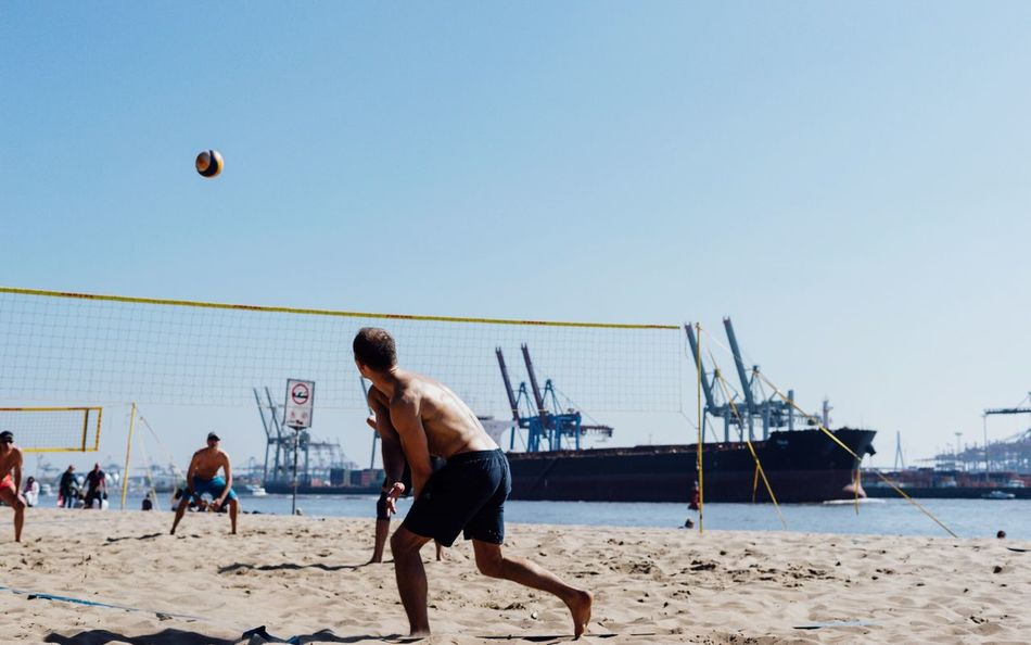 Summer and the city... Beach Sand Volleyball - Sport Sea Beach Volleyball Sport Playing Mid-air Activity Shirtless Leisure Activity Sky Team Sport Men Outdoors Soccer Competitive Sport Motion Competition Lifestyles Sommergefühle