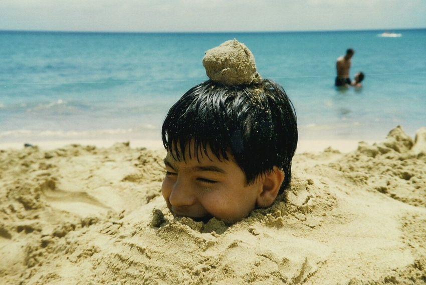 Beach Sand Sea Water Buried In Sand Summer
