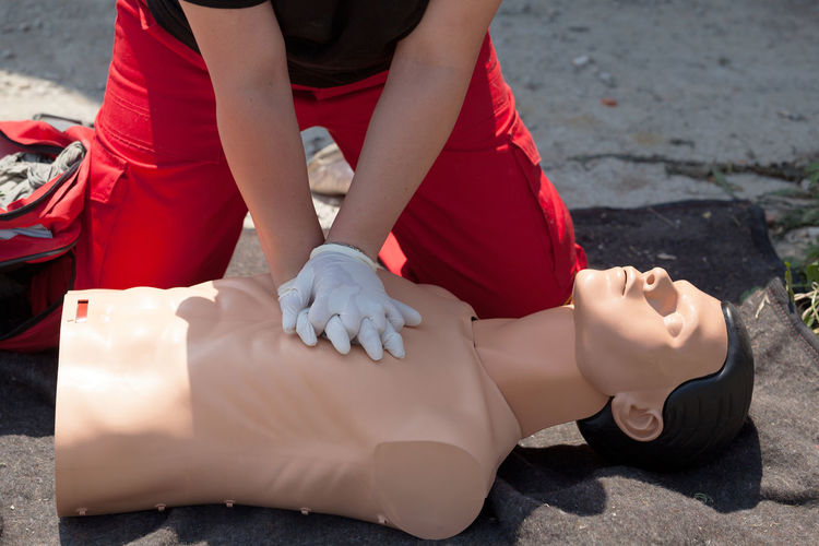 First aid training. CPR being performed on a medical-training manikin Aid CPR  Care Doctor  Emergency First Instructor Paramedic Cardiac Cardiopulmonary Resuscitation Chest Compression Dummy Health Heart Help Injury Massage Massaging Procedure Rescue Resuscitation Saving Training Urgency