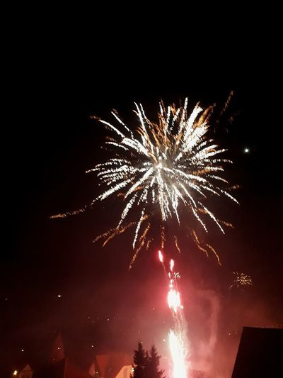 Illuminated Arts Culture And Entertainment Firework Display Celebration Awe Firework - Man Made Object Motion Long Exposure Event Multi Colored Firework Lit Sparks Explosive Exploding Entertainment
