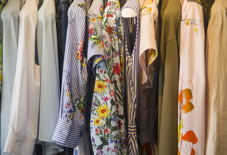 Dress Retail  Choice Variation Clothing For Sale Indoors  Store Multi Colored In A Row No People Collection Hanging Arrangement Shopping Side By Side Fashion Retail Display Large Group Of Objects Small Business Order Consumerism Rack Floral Pattern Sale
