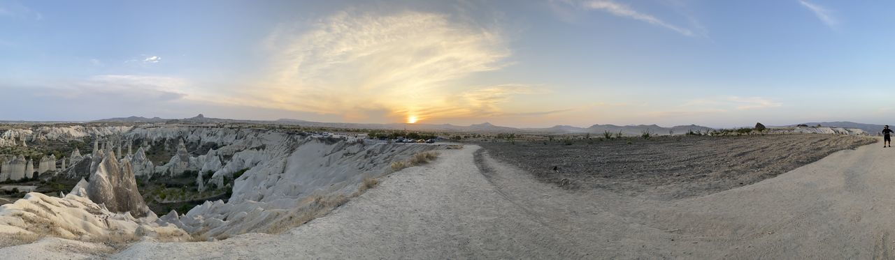 Panoramic view of land against sky during sunset