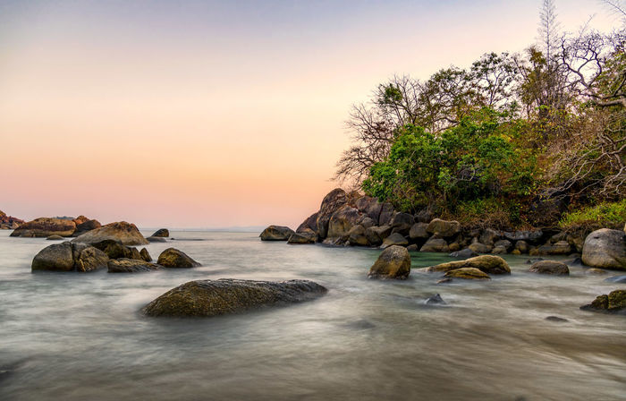 Sunset Rock - Object Sea Outdoors No People Water Nature Tranquility Sunlight Day Horizon Over Water Beauty In Nature Scenics Landscape Sky Tree Beach