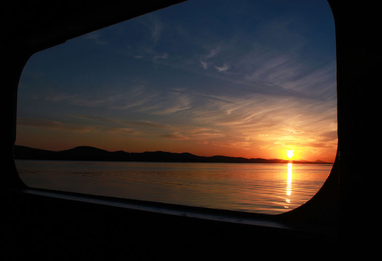 Sunset on the Ferry Beauty In Nature Close-up Day Sea Nature No People Outdoors Reflection Scenics Silhouette Sky Sunset Tranquil Scene Tranquility Water