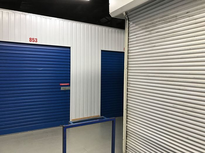 Blue Blue Doors Blue Roller Doors Blue Shutters Closed Documenting Space Doors Empty Factory Factory Doors Indoor Photography Indoors  Industrial Industrial Interior Industrial Interiors Multi Colored No People Roller Doors Shutter Storage Storage Facility Storage Room Walls White White Walls