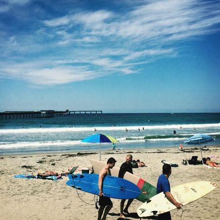 Surfers Soaking Up The Sun Surf Cali Enjoying The Sun