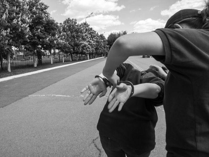 Policewoman arresting woman on street