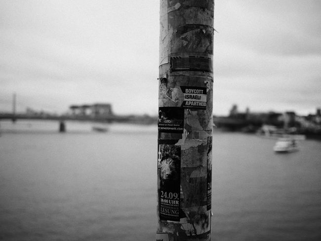 Cologne Blackandwhite Close-up Communication Day Focus On Foreground Nature Nautical Vessel No People Outdoors Sea Sky Streetphotography Text Water