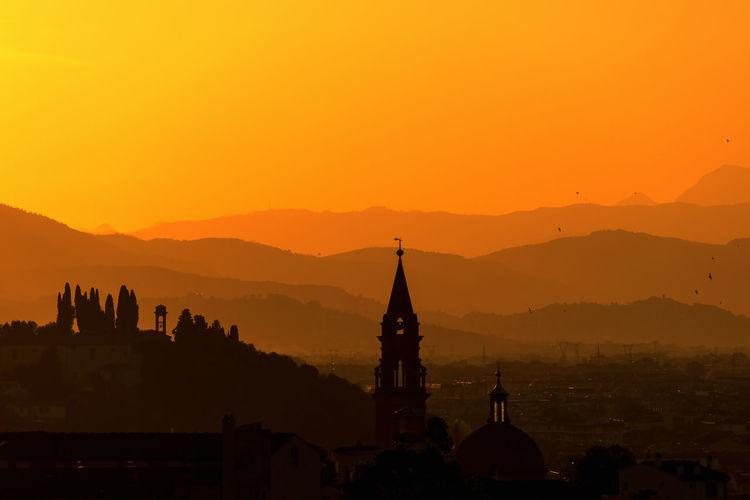 Silhouette church against sky during sunrise