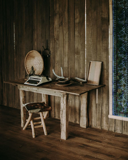 Table and chair on hardwood floor in a vintage setting