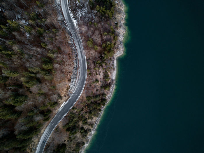 Aerial view of road by river against sky