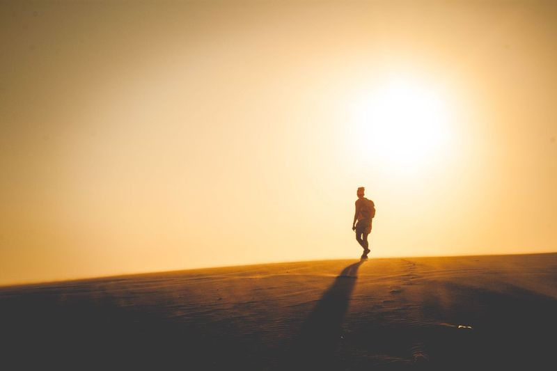 Lonely Sunset Full Length Sun Silhouette Nature Sunlight Lifestyles Walking Beauty In Nature Desert Scenics Tranquil Scene One Person Sand Real People Tranquility Outdoors Landscape Exercising Clear Sky Phan Thiet Vietnam Lost In The Landscape