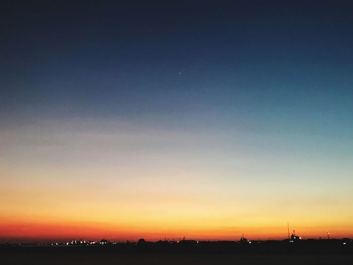 Scenic view of silhouette landscape against clear sky at sunset