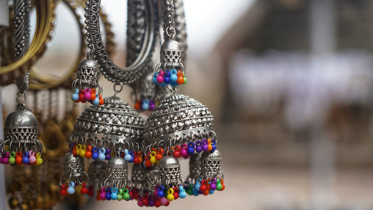 art and craft, hanging, close-up, focus on foreground, no people, for sale, retail display, selective focus, retail, craft, market, jewelry, variation, choice, creativity, souvenir, large group of objects, design, multi colored, day, sale, personal accessory, ornate