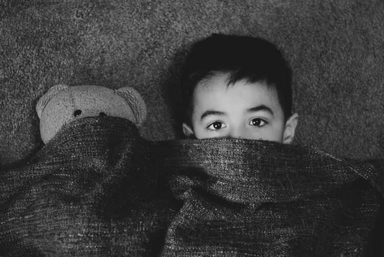 Close-up portrait of child in bed