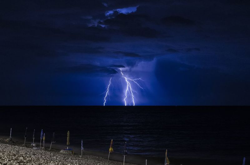 Lighting over sea at night