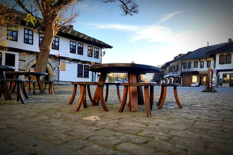 Empty street Chears Table Tree Bulgaria Street Streetphotography Morning Sky Morning Empty No People Tryavna Pavement Cobblestone Coblestone Street Stones Wood - Material Playground Sky Architecture Building Exterior Built Structure Wooden Street Scene Cobbled Outdoor Cafe