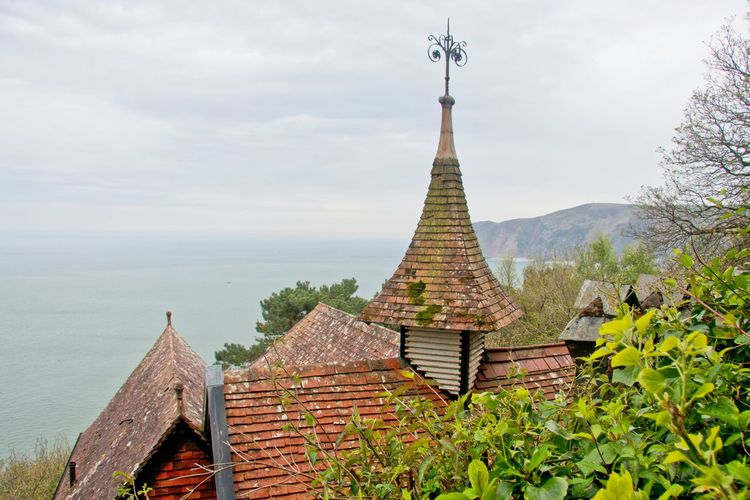 View of roofed structures overlooking sea