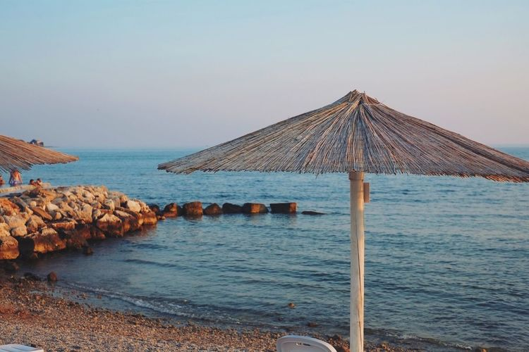 View of thatched umbrella on the beach