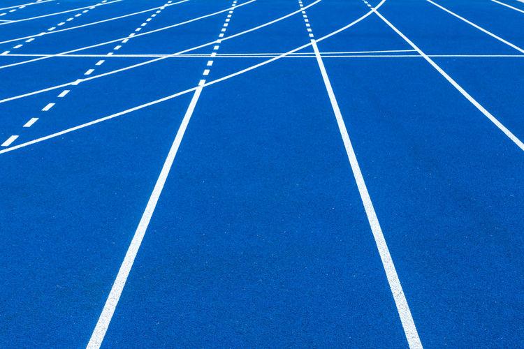 Full frame shot of blue sports track