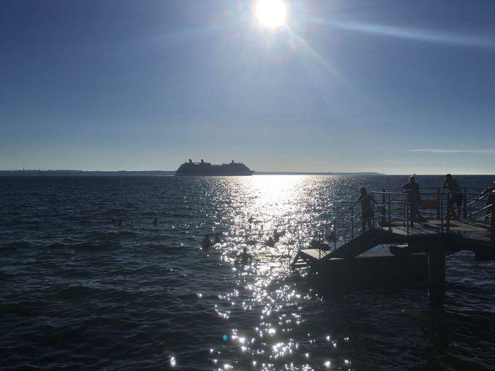 People taking a swim in the Öresund in the heat of July. Water Sky Sea Sunlight Swimming Swedish Summer Helsingborg  Brygga Waterfront Clear Sky Nautical Vessel Sunbeam Lens Flare Horizon Horizon Over Water öresund Sun Reflection Bright Outdoors Cruise Ship Tranquility