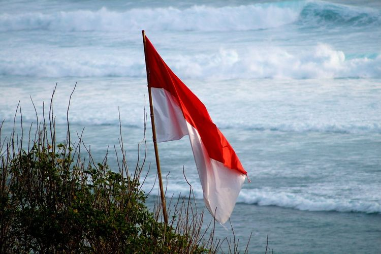 Indonesian Flag Red And White Indonesia Raya South East Asia Photography INDONESIA Bali Tropical Climate Waves Ocean Nature Indonesian Flag Indonesian National Symbol National Identity Patriotism Identity Asean Blowing Flying Red Sea Flag Patriotism Wind Shore Wave Symbolism Beach Surf Tide
