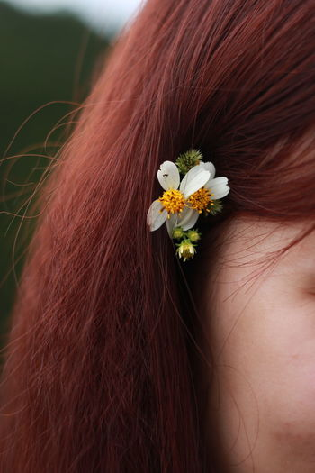 Close-up of woman with flower hair