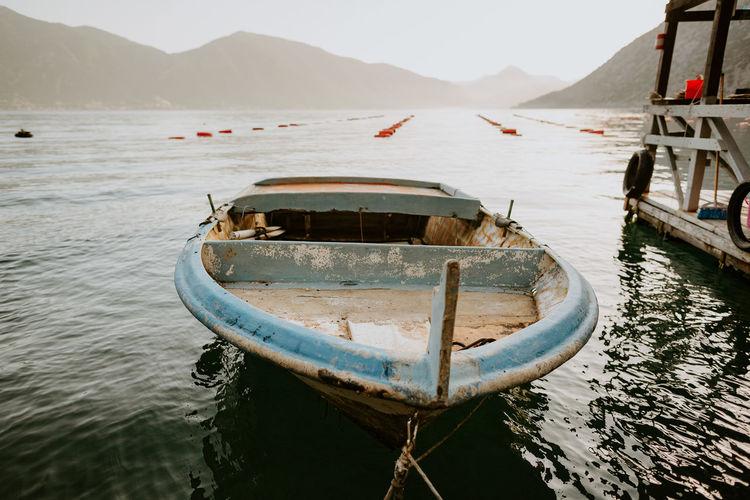 Boat moored in lake against sky