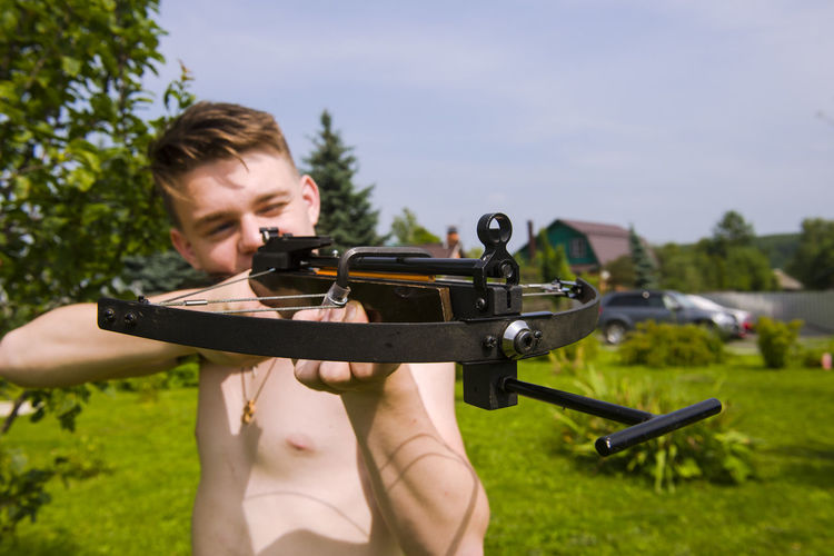Close-Up Of Man Holding Crossbow