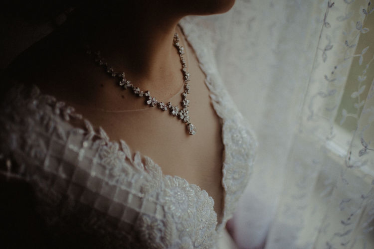 Close-up of woman wearing necklace