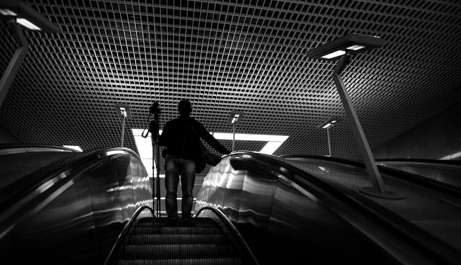 Low Angle View Of Man With Tripod On Escalator At Maryina Roshcha Metro Station