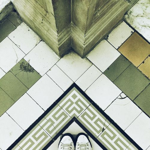 High angle view of pair of shoes on tiled floor