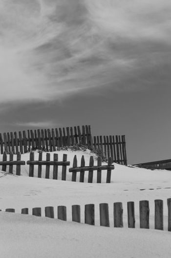 Wooden Fence On Snowcapped Landscape