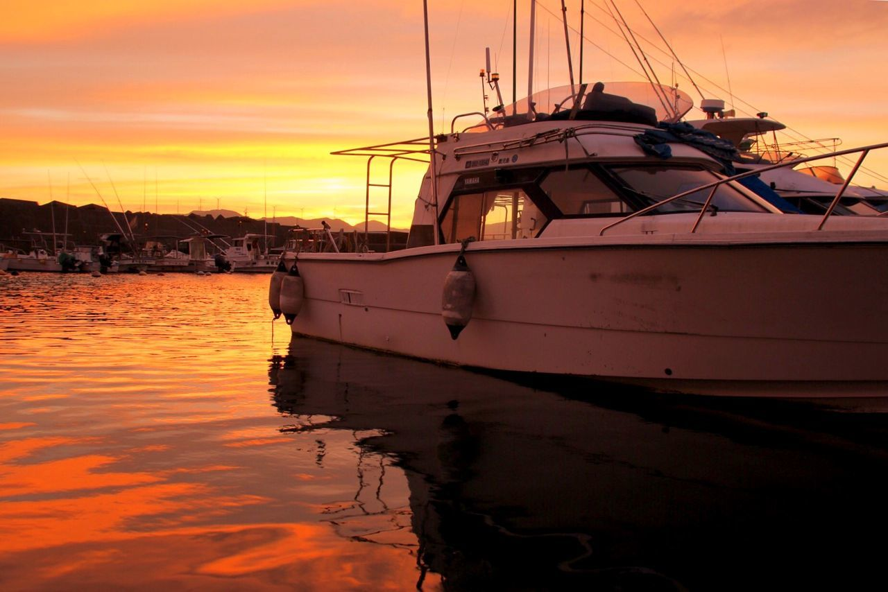 nautical vessel, transportation, mode of transport, sunset, moored, water, boat, sky, orange color, nature, reflection, cloud - sky, outdoors, scenics, beauty in nature, no people, sea, mast, tranquility, tranquil scene, sailboat, harbor, sailing, yacht, sailing ship, day