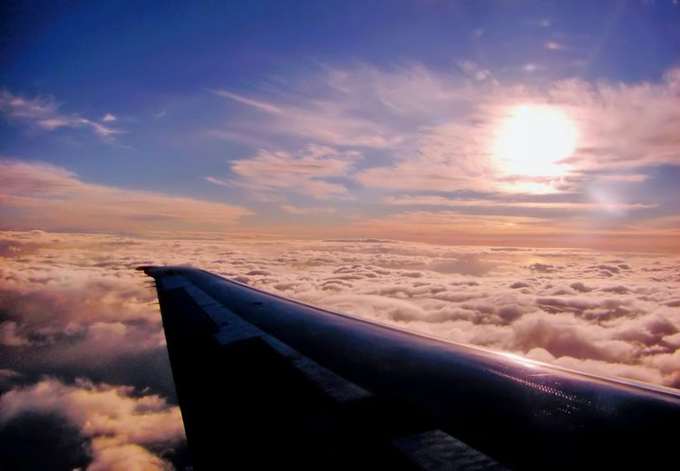 Sunset above the clouds! Bon voyage! Air Vehicle Aircraft Wing Airplane Beauty In Nature Cloud Cloud - Sky Clouds And Sky Cloudscape Cropped Dramatic Sky Flying Idyllic Majestic Mode Of Transport Nature Part Of Scenics Sky Sun Sunlight Sunset Tranquil Scene Tranquility Transportation Wing