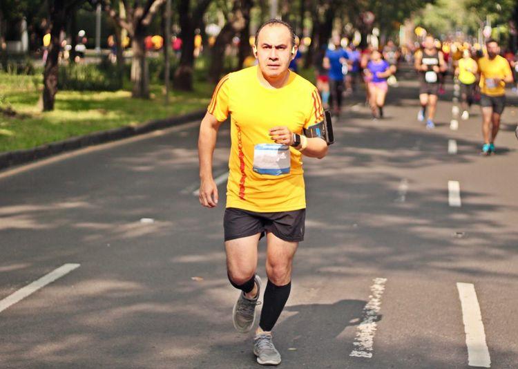 Portrait of man running on road during marathon