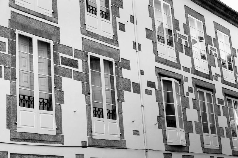 Architecture Balconies Black And White Building Exterior Day Facades Monochrome No People Old Buildings Outdoors Stone Buildings Street Photography Streetphoto_bw Town Traditional Architecture Village Windows