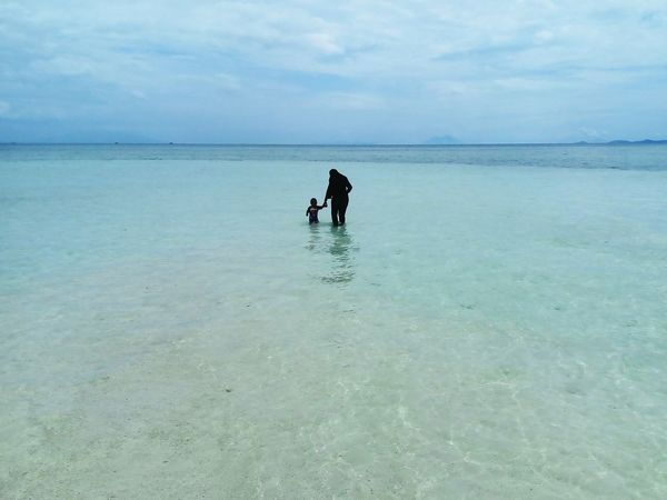 Beach Sea Horizon Over Water Sand People Pastel Colored Day Landscape Outdoors Swimming Water Nature Sky One Person Child Wave Beauty In Nature Adult Young Adult INDONESIA Lampung